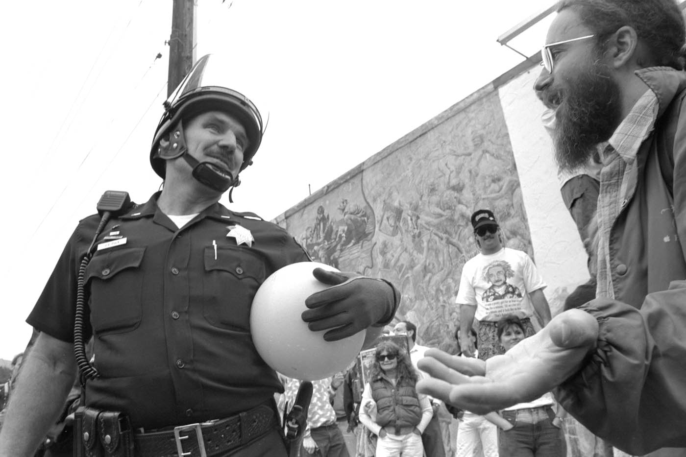 BPD officer actually having fun between demonstrations.