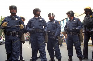 Five police officers on Telegraph Avenue during the Berkeley People's Park riots, 1991.