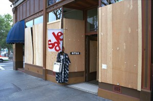 Sale! Boarded up, but the store's still open...