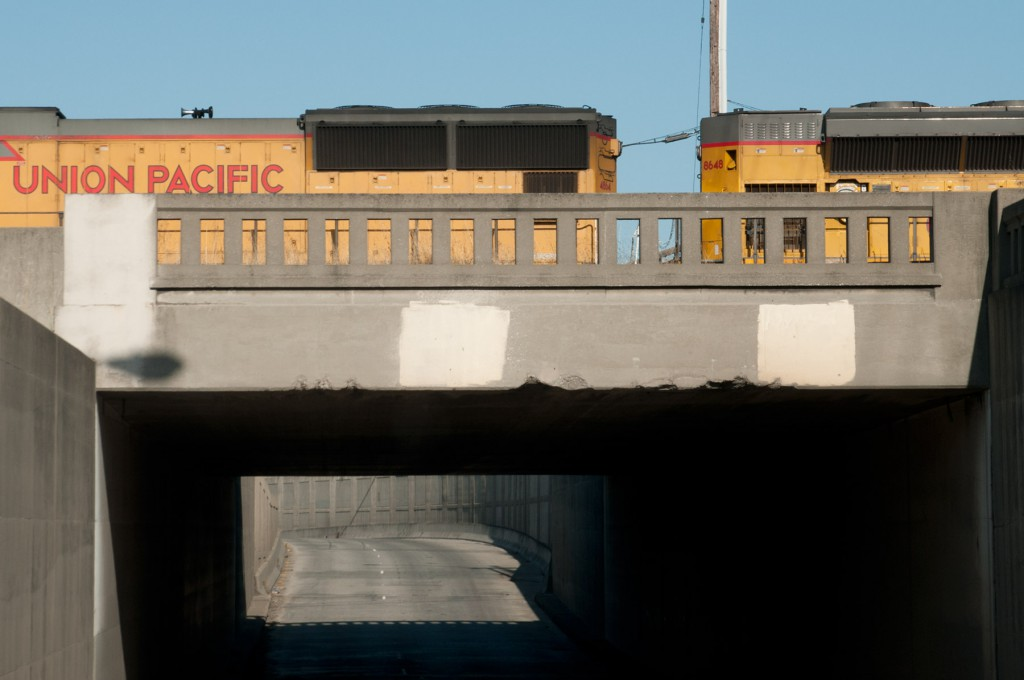 Union Pacific diesel locomotives crossing over East 7th, Oakland, California.