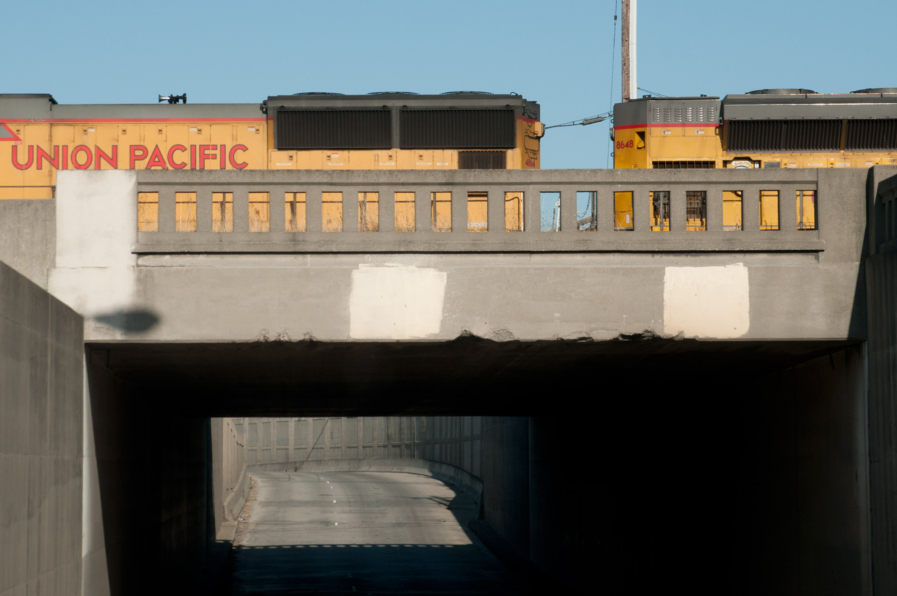 Union Pacific diesel locomotives crossing over West 7th, Oakland, California.